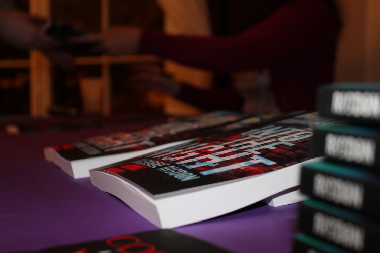 Action shot; foreground of those beautiful books!